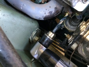 Drilling out a 440 exhaust stud hole.